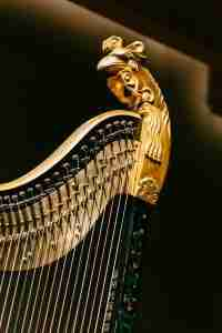 gold partial of a harp